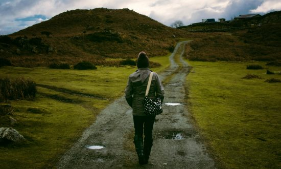 person-walking-down-the-path-with-a-bag-550x330.jpg